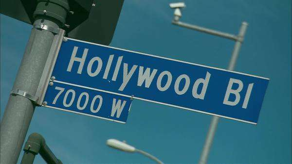 Rack focus of street sign of Hollywood Boulevard Rights-managed stock video