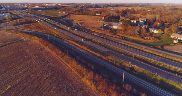 Highway traffic casting long shadows in the light of sunrise  stock footage