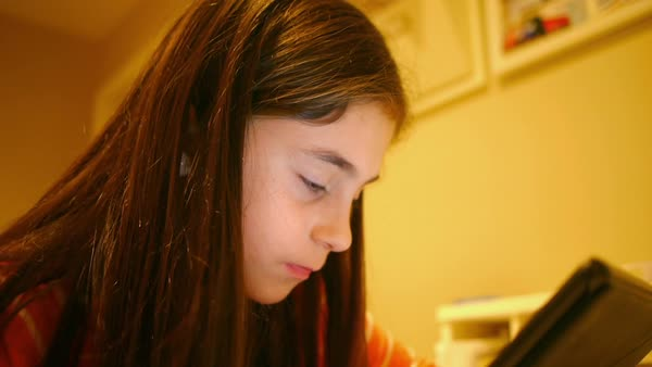Hand-held shot of a girl using a tablet Royalty-free stock video