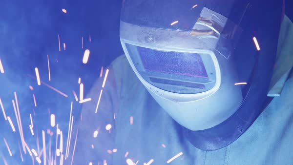 Close up of a worker welding in a US manufacturing factory. Royalty-free stock video