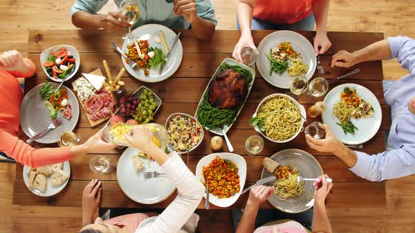 Fine Group Of People Eating At Table With Food Stock Footage Download Free Architecture Designs Embacsunscenecom