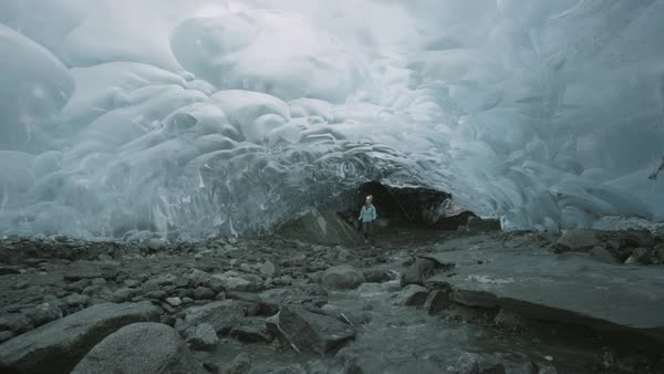 Hand-held shot view of a woman entering the Mendenhall Ice Caves Royalty-free stock video