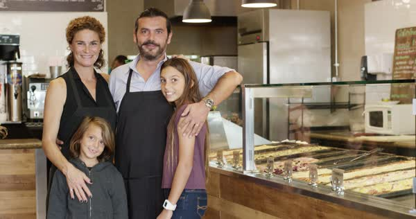 Pizzeria owners posing with children at display case Royalty-free stock video