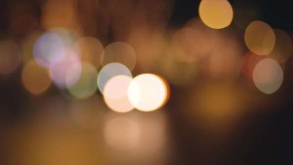 Bokeh of cars driving by and city lights at night Royalty-free stock video