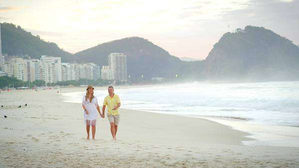 Brazilian couple walk down a beach in Brazil Royalty-free stock video