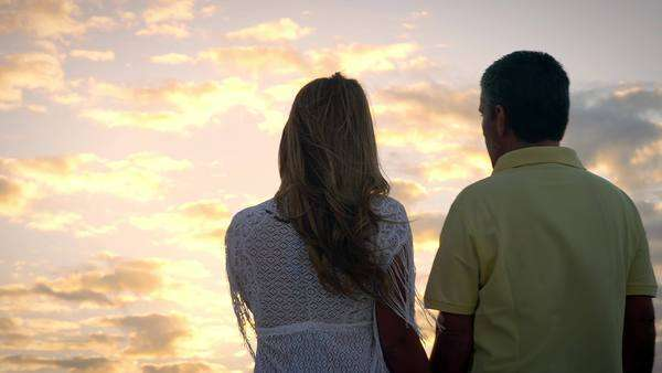 Brazilian couple embrace and look out over the ocean Royalty-free stock video