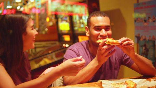 A young couple eating at a downtown pizzeria Royalty-free stock video