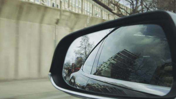 Rear view mirror view on road Royalty-free stock video