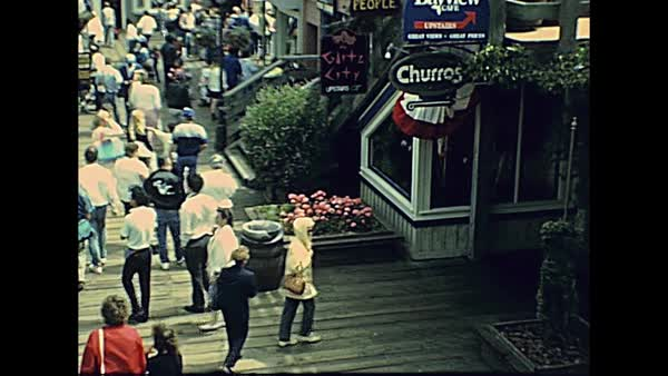 San Francisco, California, United States - in 1980: Archival eighties  tourist crowd in shops and restaurants of shopping center at Pier 39,