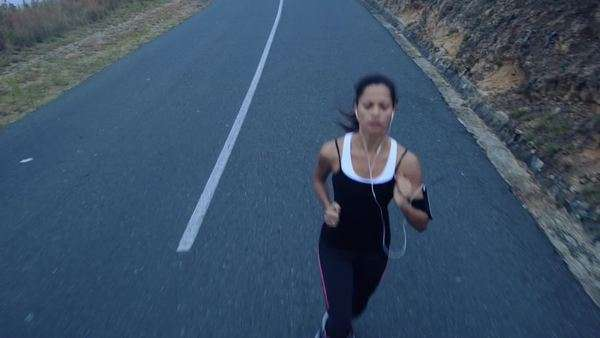 Woman running on road, close-up of shoes Royalty-free stock video