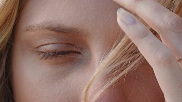 2f6acc4dd52 Close up beautiful blue eyes of blonde woman looking contemplative natural  beauty concept
