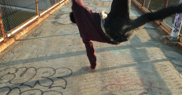 Slow motion young man break dancing on city bridge Royalty-free stock video