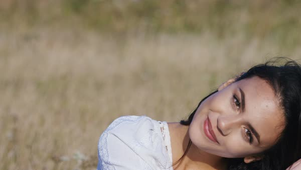 Portrait of a beautiful young and confident woman smiling to camera, in slow motion Royalty-free stock video