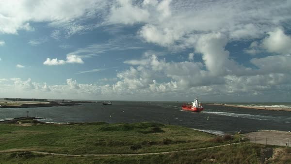 Time lapse of the freighter traffic along the North Sea canal seen from  IJmuiden Island  stock footage