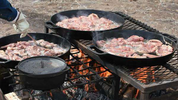 Bbq Lamb And Mutton Steaks Chops Cooking In Cast Iron Pans Over An Open Outdoor
