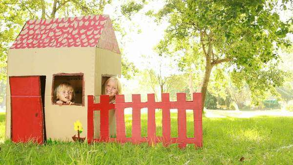 Video of happy little children sitting in playhouse. Royalty-free stock video