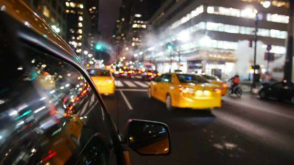 Yellow Cabs taxi driving through Manhattan in New York Royalty-free stock video