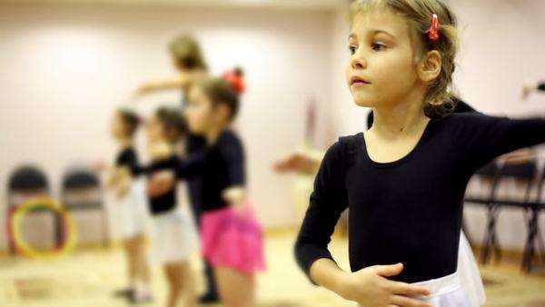 Girls learn how to dance with ballet teacher in recreation center Royalty-free stock video