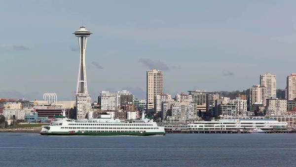 WA, Seattle, Washington State Ferry, with Seattle skyline Rights-managed stock video