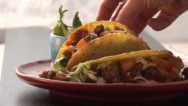 Taco shells filled with mince, fresh coriander Royalty-free stock video