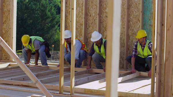 Group of construction workers staning up wall Royalty-free stock video