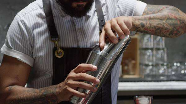 Medium close-up shot of bartender preparing a cocktail Royalty-free stock video