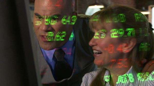 Two City Types Look Pleased And Happy As Stock Market Ticker Symbols