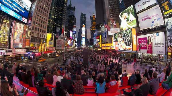 Wide angle view of people enjoying the neon lights of 42nd Street, Times Square, Manhattan, New York City, New York, United States of America, North America, Time-lapse Royalty-free stock video