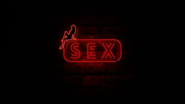 Animation of the word sex at neon light at wall with red light stock footage