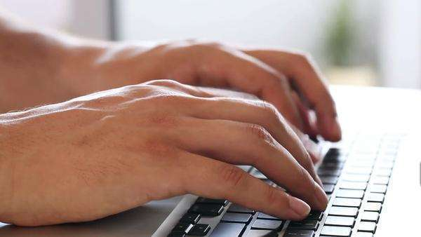Close-up of male hands typing on a laptop keyboard. Royalty-free stock video
