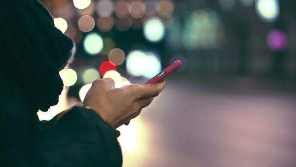 Hand of a Woman Texting on the Street at Night Royalty-free stock video