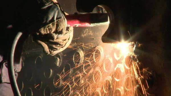 Close up of grinder causing sparks Rights-managed stock video