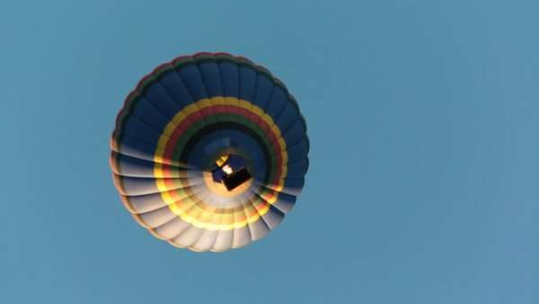 Low angle shot of a hot air balloon passing over the camera Royalty-free stock video
