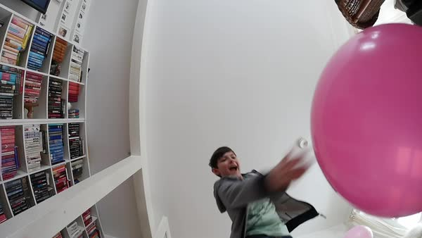Worm's-eye view of a boy playing with balloons Royalty-free stock video