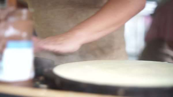 Close-up shot of person preparing crepes Royalty-free stock video