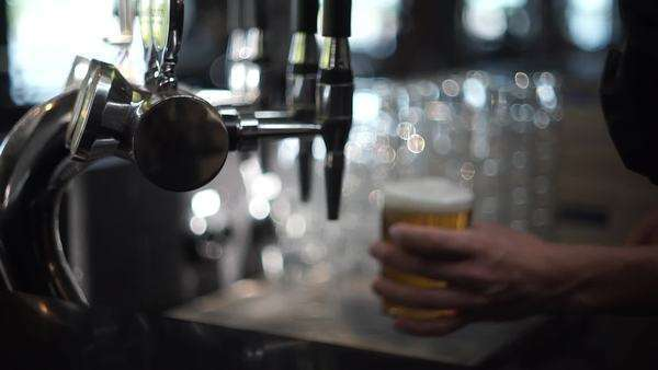 Close-up shot of a person tapping beer Royalty-free stock video