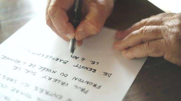 Close-up shot of man writing on a paper Royalty-free stock video