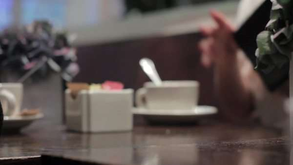 Locked off shot of receiving the bill at a restaurant table Royalty-free stock video