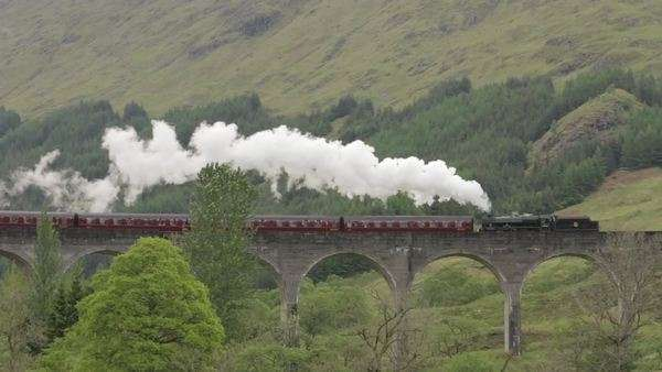 Stunning shot of the Jacobite Steam Train going over the Glenfinnan viaduct in the Scottish highlands Royalty-free stock video