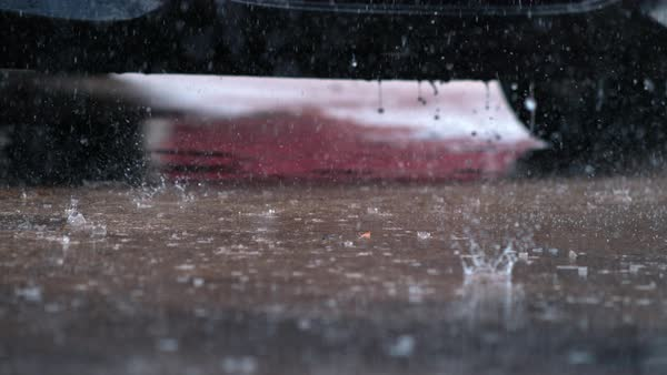 Super slow motion rain hitting pavement Royalty-free stock video