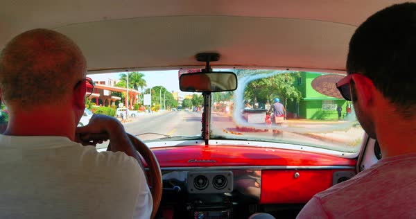Point of View Inside Car, POV from Driver of Classic Cuba Car stock footage