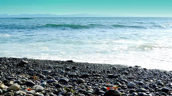 West coast rock stone beach, blue ocean waves stock footage