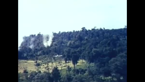 1963, 1964— US Air Force planes fly in Vietnam and bomb and fire weapons   stock footage