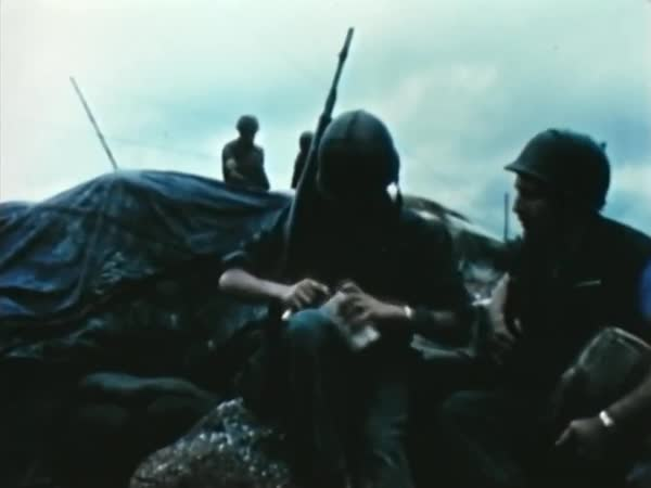Soldiers hike, shave, wash in a stream, cross a river and interact with  villagers as sailors navigate warships, during the Vietnam War, in 1967   stock