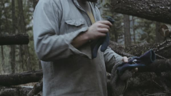 Hand-held shot of a man putting his gloves into his pocket Royalty-free stock video