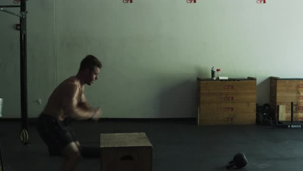 Male crossfit athlete doing box jumps Royalty-free stock video