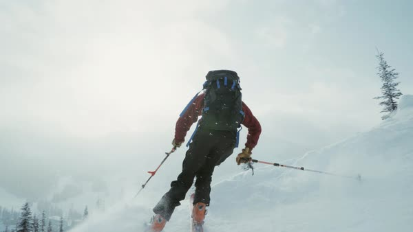 Low-angle shot of a man skiing down on a slope Royalty-free stock video