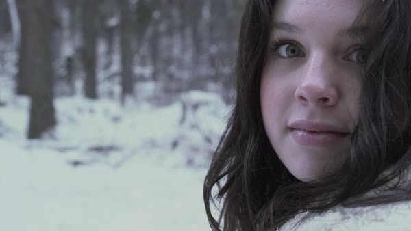 Push-in shot of a young woman standing in a winter forest Royalty-free stock video