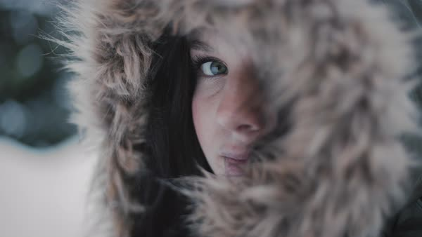 Hand-held shot of a woman in a hooded jacket Royalty-free stock video