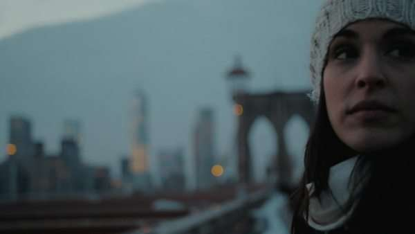 Cinematic shot of young woman looking at Manhattan while standing on Brooklyn Bridge Royalty-free stock video